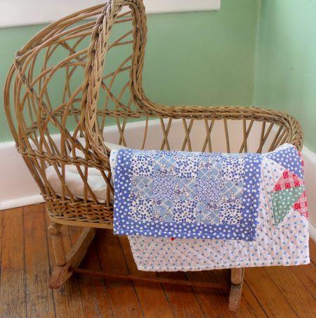 Cradle w quilts
